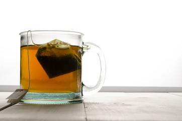 Cup of green tea far left
