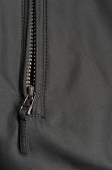 Black polyester fabric texture background open jacket zipper