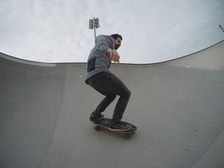 Skater landed trick in pool of skatepark
