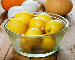Lemons in a glass plate close up