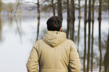 Man in jacket observing the river
