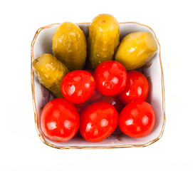 Salty marinated tomatoes and cucumbers in plate