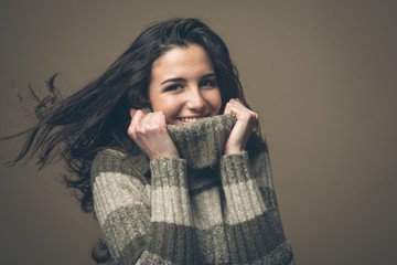Smiling woman with high collar sweater