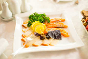 raw fresh uncooked salmon red fish fillet on plate with lemon