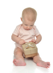Infant child baby toddler kid with small rustic  hand made prese