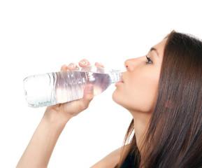 Woman drinking water from plastic bottle