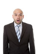 astonished businessman scared in shock and surprise