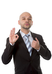 businessman giving ok hand sign in work success concept