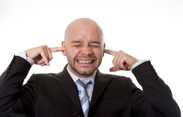 businessman in stress covering ears with fingers