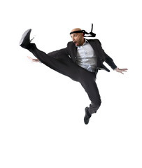 businessman wearing suit jumping in karate kick attack