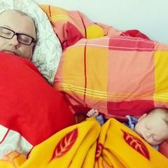 Father sleep baby boy together