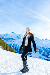 Pretty blonde girl smiling in the Alps.