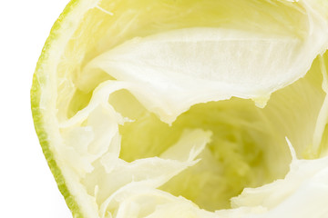 squeezed lime on white background