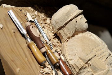 chisels with a wooden statue