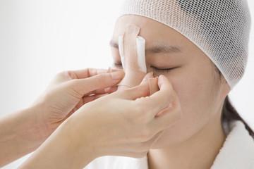 Women undergoing shaping nose