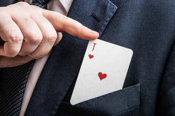 hand pulls the card ace of hearts