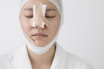 Women bandaged face