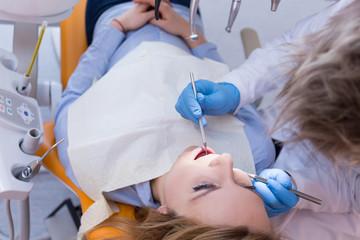 Dentist doing dental check-up