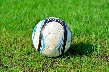Football of  on green grass