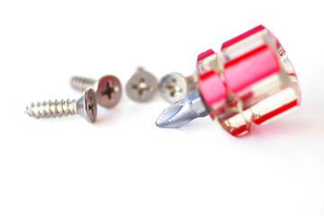 Screws and screwdriver - Stock Image