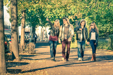 Group of happy best friends walking in Berlin streets