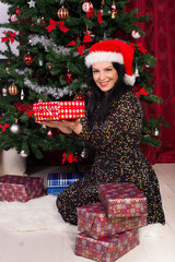 Happy woman showing Christmas gifts