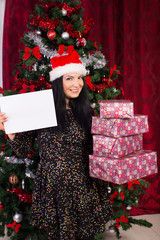 Woman holding stack of presents