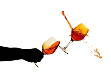 swill wine glass with man hand silhouette and collision of glass