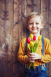 canvas print picture - Boy with tulips