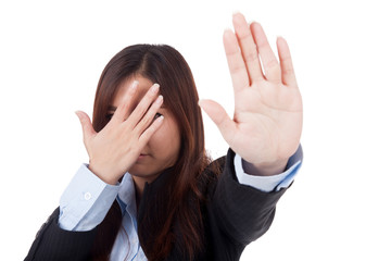 Young Asian businesswoman hide her face say no