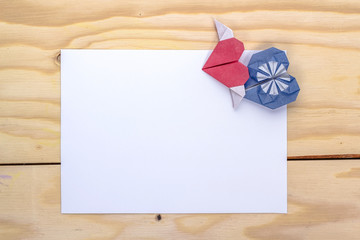 valentines card with origami blue and red hearts