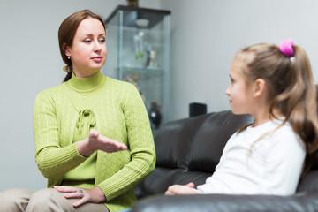 Woman berating daughter in home