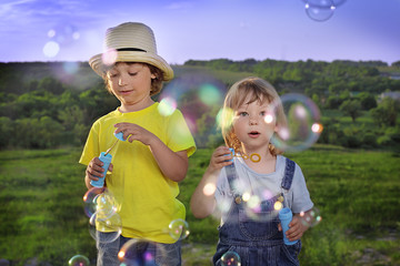 boy play in bubbles