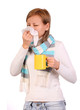 Sick woman with cup of tea sneezing in tissue isolated on white.