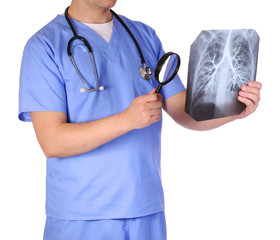 Doctor with stethoscope and magnifying glass examining x-ray
