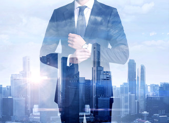 Double exposure of businessman and megalopolis