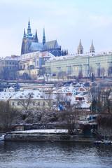 Snowy Prague gothic Castle above River Vltava, Czech Republic