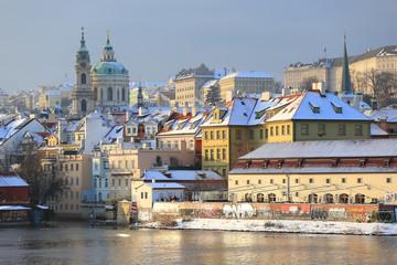 Romantic snowy Prague St. Nicholas' Cathedral, Czech Republic