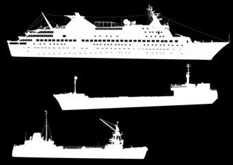 three commercial ships isolated on black