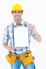 Confident carpenter holding clip board