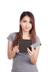 Young Asian woman with blank card and tablet PC