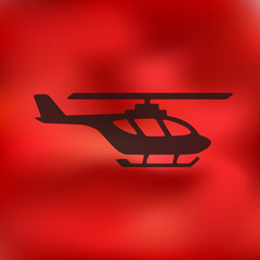 helicopter icon on blurred background