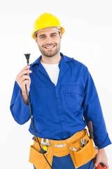 Smiling repairman holding electric plug