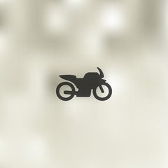 motorcycle icon on blurred background