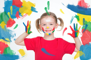 young child showing her hands after her art lesson