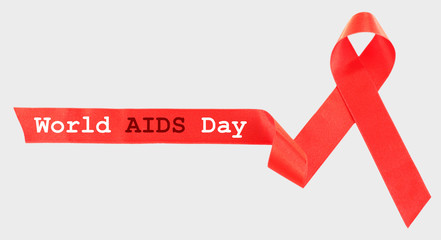 Red AIDS ribbon on light background