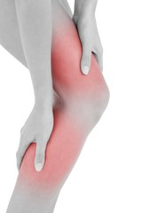 Closeup mid section of a fit woman with leg pain