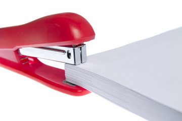 red stapler and paper