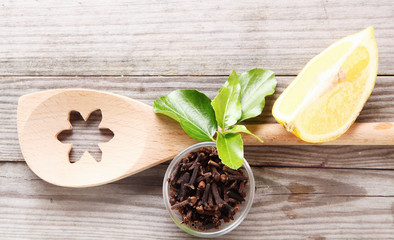 Decorative wooden spoon with cloves and lemon