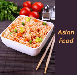 Asian food, noodles in bowl with vegetables and space for your